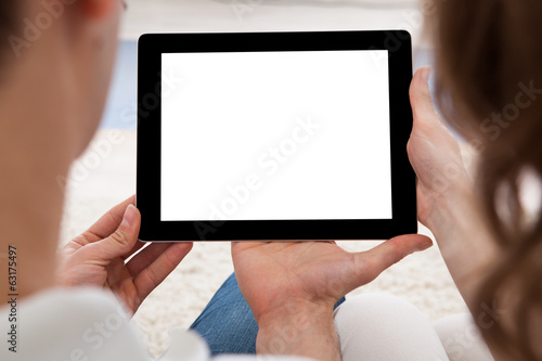 Young couple looking at a tablet together