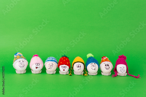 Easter eggs with faces and knit colorful hats
