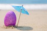 Fototapety Easter egg on the beach
