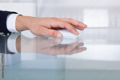 Businessman's Hand Using Wireless Mouse