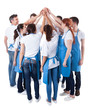 canvas print picture - Group of cleaners making high five gesture