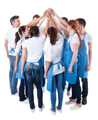 Group of cleaners making high five gesture