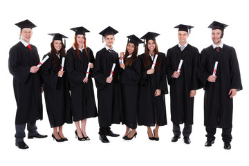 Group of student graduates with their diplomas