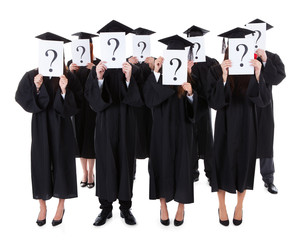 Graduate students showing question signs