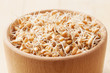 wheat sprouts in wooden bowl