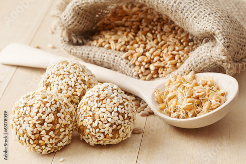 balls from wheat sprouts with sesame seeds, sprouted grains
