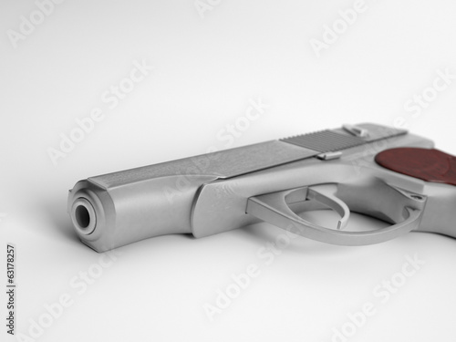 Closeup of handgun on white background