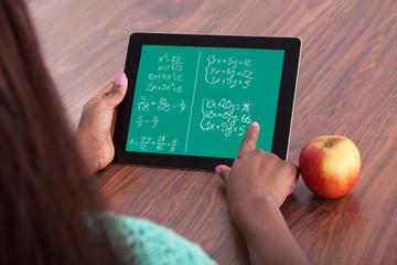 Student Solving Math Problems On Digital Tablet