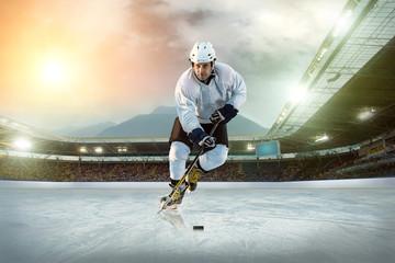 Ice hockey player on the ice. Open stadium - Winter Classic game