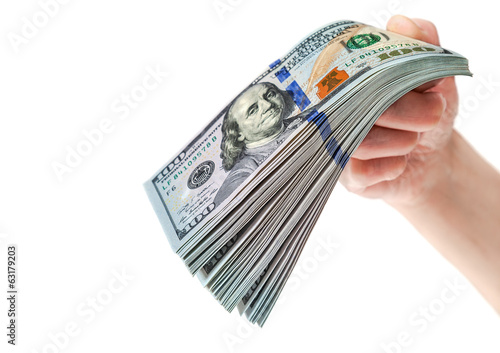 Hand with stack of one hundred dollar bills isolated on white ba