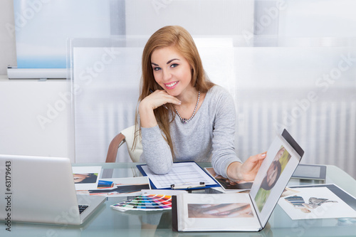 Woman Holding Photo Album