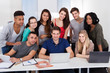 University Students Using Laptop Together