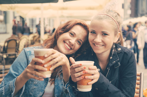 Teenage Girls Drinking at Bar - 63180006