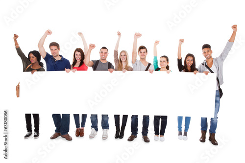 Successful College Students Displaying Blank Billboard