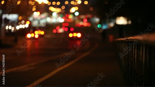 Car driving Rush-hour Traffic in city night with defocus lens
