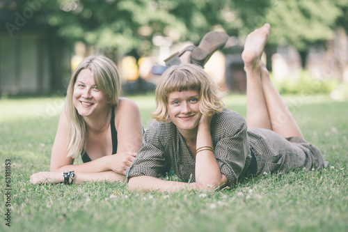 Two Russian Girls Lying on the Lawn