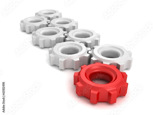 cooperation teamwork leadership concept gears with one red