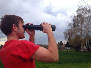 Man looking through the spyglass