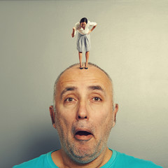 man with angry wife on his head