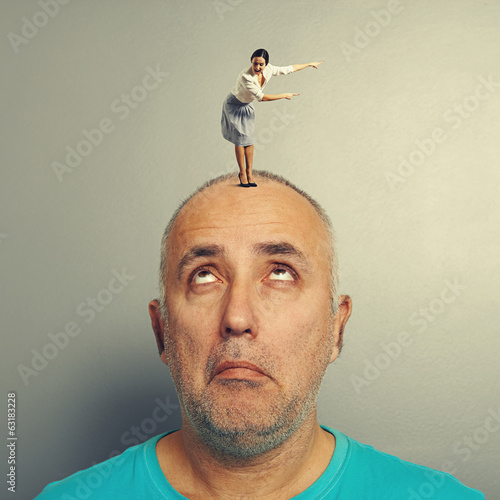 man looking at excited woman
