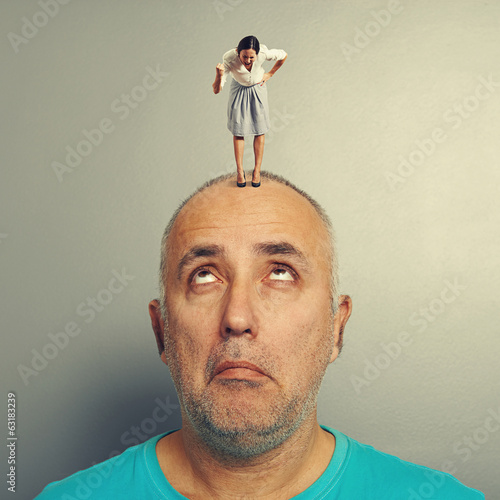 man with small angry businesswoman