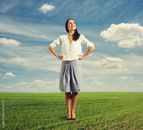 young smiley woman on the green field