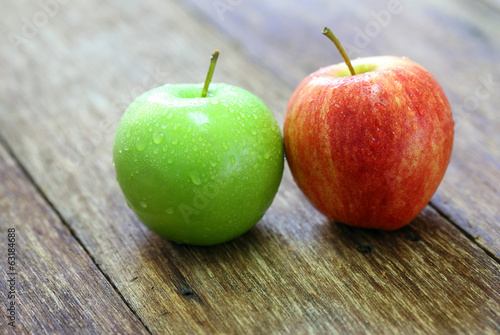 red and green apple fruit on wood background