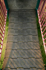 Detail of child's playground (post and ladder, metal parts)
