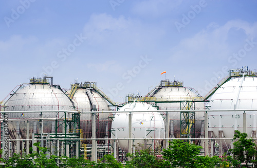 The silver and white huge storage natural gas tanks