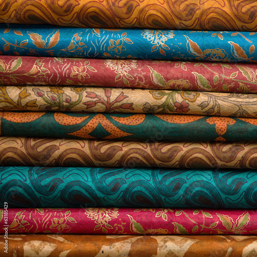 Heap of cloth fabrics at a local market in India. Close up .