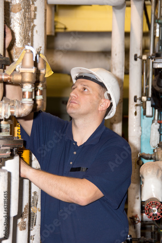 Engineer with hard hat in power plant