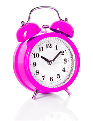 pink alarm clock isolated on white background