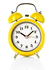 yellow alarm clock isolated on white background