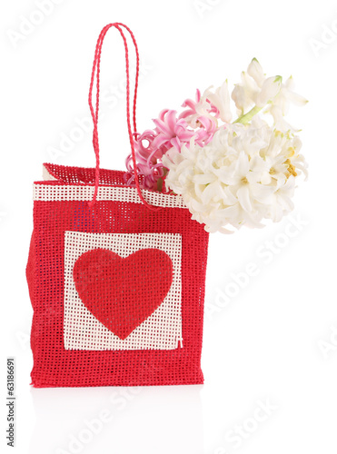 Gift bag with flowers isolated on white