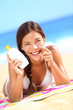 Suntan lotion woman applying sunscreen solar cream