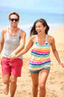 Beach vacation - happy fun romantic couple