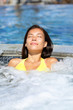 Spa wellness - woman relaxing in hot tub whirlpool