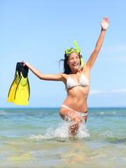 Beach vacation woman happy snorkeling