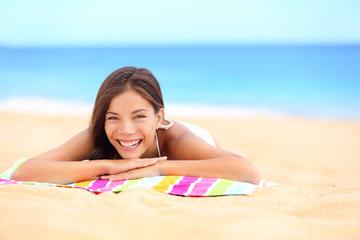 Beach summer woman sunbathing enjoying sun smiling