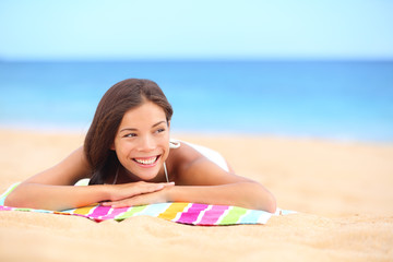 Summer beach woman sunbathing enjoying sun smiling