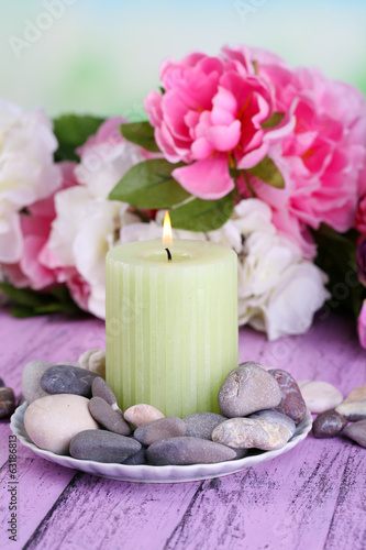 Composition with spa stones, candle  and flowers