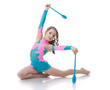 Adorable girl exercising with gymnastic mace