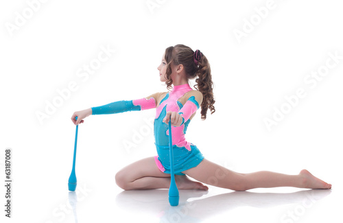 Curly girl doing gymnastic exercises with mace