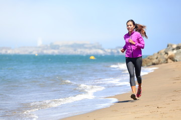 Woman running on San Francisco beach