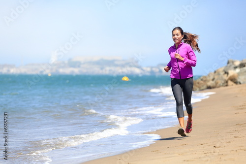 Woman running on San Francisco beach