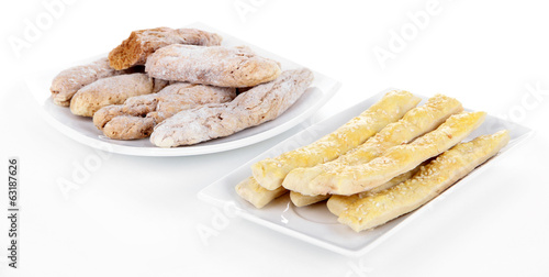 Variety of bread sticks isolated on white
