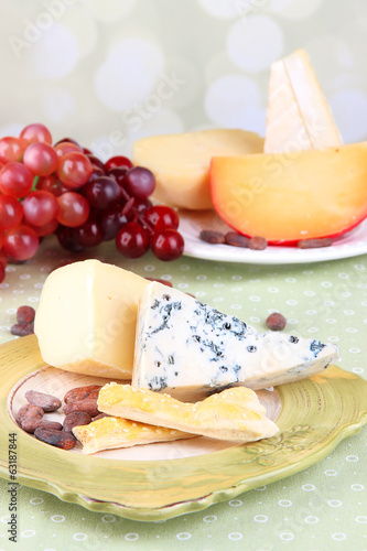 Assorted cheese plate , grape, bread sticks.