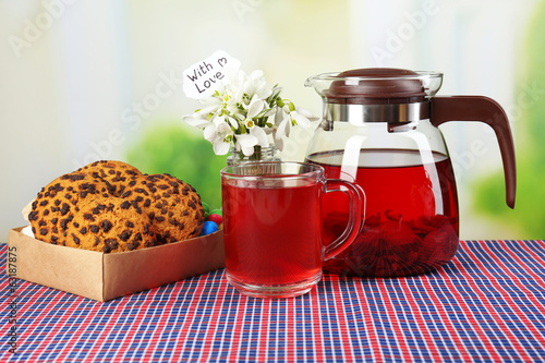 Tasty herbal tea and cookies on table