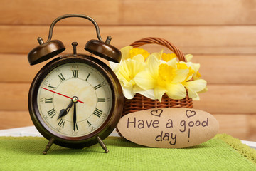 Alarm clock on table, on wooden background