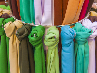 Scarves in various shades of the storefront